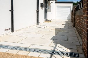 Natural stone driveway fitted with drainage channel